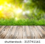 wood floor top on bokeh green... | Shutterstock . vector #315741161