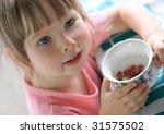 young girl eating berries | Shutterstock . vector #31575502