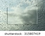 frame made of rain on glass | Shutterstock . vector #315807419