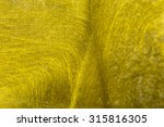 Small photo of gold fiber texture aflutter, background