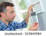 electrician fitting an... | Shutterstock . vector #315845984