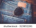 Sunglasses In Jeans Back Pocke...