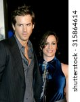 Small photo of HOLLYWOOD, CA - DECEMBER 07, 2004: Ryan Reynolds and Alanis Morissette at the Los Angeles premiere of 'Blade: Trinity' held at the Grauman's Chinese Theater in Hollywood, USA on December 7, 2004.