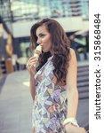 young girl eating ice cream in... | Shutterstock . vector #315868484