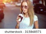 pretty girl with milk shake... | Shutterstock . vector #315868571