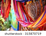 ethnic blankets and hammocks... | Shutterstock . vector #315870719