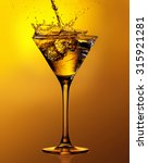 martini cocktail with splash... | Shutterstock . vector #315921281