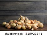 onions in a group on wood table