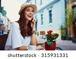 happy tourist talking on mobile ... | Shutterstock . vector #315931331