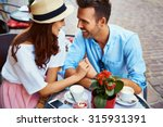 Stock photo couple in love sitting in cafe looking at each other 315931391