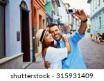 happy couple of tourists taking ... | Shutterstock . vector #315931409