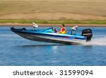 Man Driving A Fast Boat With...