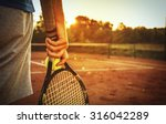 Close Up Of Man Holding Tennis...