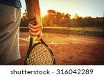 Close Up Of Man Holding Tennis...