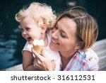 mother and daughter eat ice... | Shutterstock . vector #316112531