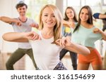 young dancing people in gym... | Shutterstock . vector #316154699