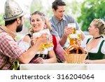 friends in bavarian beer garden ...   Shutterstock . vector #316204064
