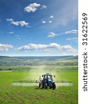 Farming Tractor Plowing And...