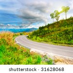 Mountain Road At Sunny Day Wit...