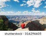 Man Sitting On Rock Overlookin...