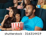 young man watching a movie with ... | Shutterstock . vector #316314419