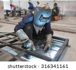 welder in factory   Shutterstock . vector #316341161