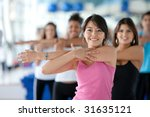 group of gym people in a stretching class - stock photo