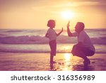 father and son playing on the... | Shutterstock . vector #316356989
