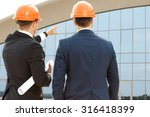 two architect assessing their... | Shutterstock . vector #316418399