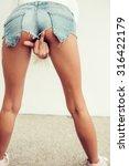 sporty girl in mini denim... | Shutterstock . vector #316422179