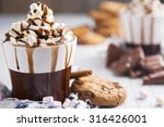 a messy cup with hot chocolate  ... | Shutterstock . vector #316426001