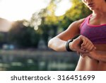 woman setting up the fitness... | Shutterstock . vector #316451699