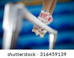 hands on the gymnastic bars | Shutterstock . vector #316459139