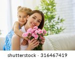 mother and daughter with flowers | Shutterstock . vector #316467419