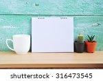 blank calendar on wood in room. | Shutterstock . vector #316473545