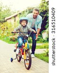 his first ride. happy little... | Shutterstock . vector #316510409