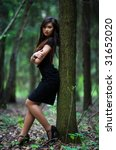 Young woman in forest. Shallow dof. - stock photo