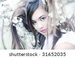 Young woman with cherry flowers portrait. Original hair style. - stock photo