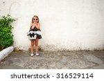 beautiful little girl in black... | Shutterstock . vector #316529114