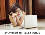 happy asia woman lying on floor ... | Shutterstock . vector #316540811