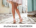 woman wearing nude colored... | Shutterstock . vector #316558004