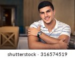 young man sitting in a... | Shutterstock . vector #316574519