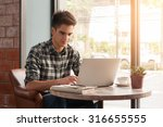 businessman using laptop with... | Shutterstock . vector #316655555