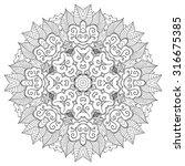 mehndi mandala tracery wheel... | Shutterstock . vector #316675385