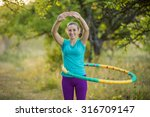 girl practicing with hula hoop... | Shutterstock . vector #316709147
