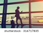 businesswoman at the airport.... | Shutterstock . vector #316717835