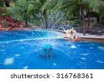 Fountain Water In Swimming Pool.