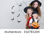 Stock photo happy brother and two sisters on halloween party 316781204