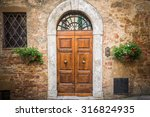 old destroyed door to the... | Shutterstock . vector #316824935