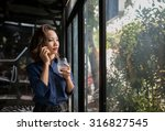 business lady drinking glass of ... | Shutterstock . vector #316827545